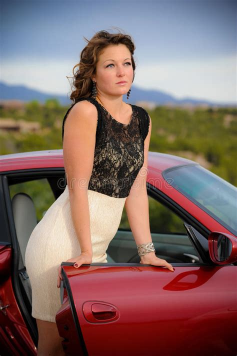 Beautiful Woman Leaning On Car Door Stock Photo - Image of
