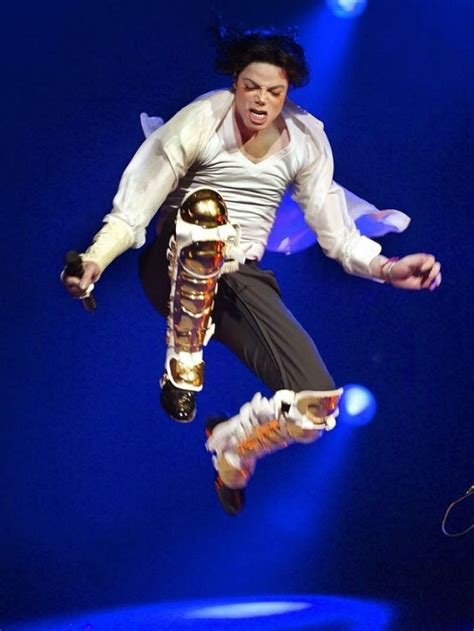 Great shot of Michael Jackson jumping in the air on stage