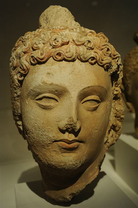 Face of Lord Buddha, head of curly hair, lips, almond shap