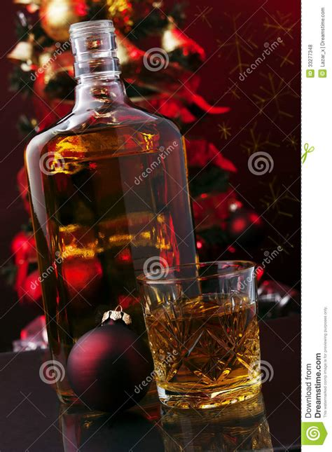 Whiskey and Christmas tree stock photo